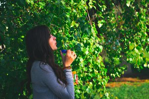 Young girl with soap on nature.