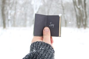 Joy christmas or winter idea. Vintage book with inscription