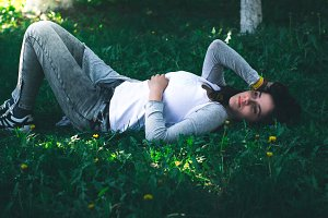 Young beautiful girl lies on the grass.