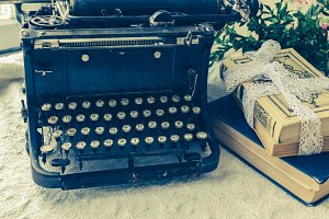 Typewriter and books on the table