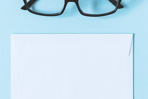 Glasses and white envelope