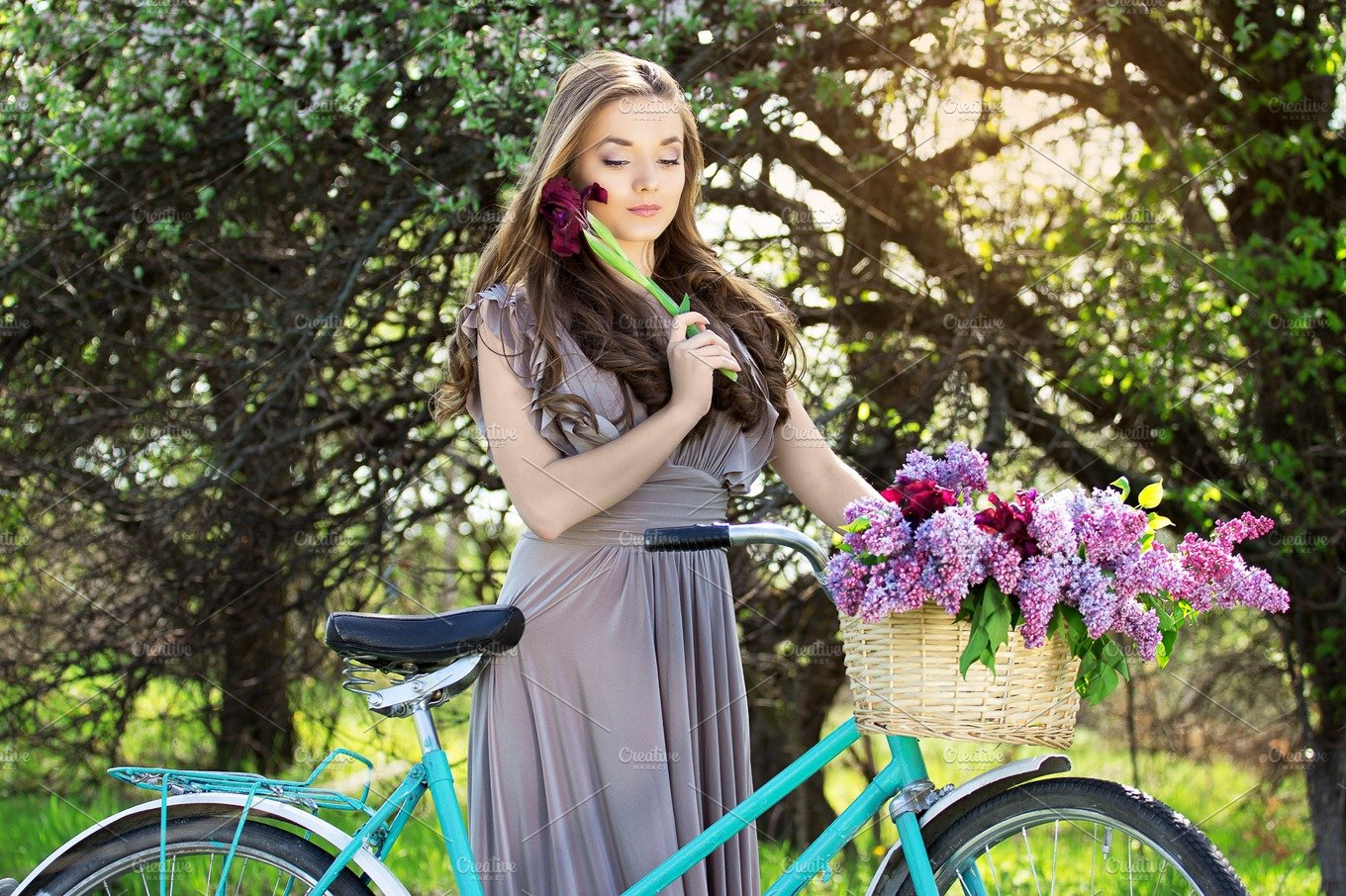 Young Beautiful Girl With Long Hair In Bright Dress With Flowers In