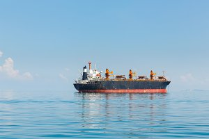 Cargo ship sailing in ocean
