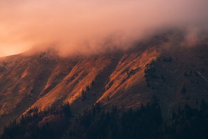 Sunset in the foggy hills
