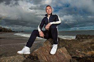 man sitting on the rocks thinking