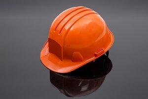 Orange protective helmet