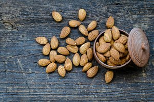 Almonds on the old wooden background
