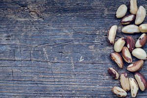 Brazil nuts on the old wooden background