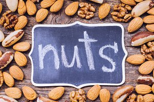 Nuts mix on wooden background