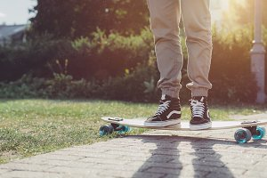 Young hipster man on longboard