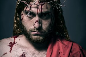 Jesus Christ struck and bleeding