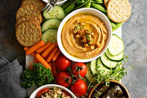 Hummus and vegetables platter with grain salad