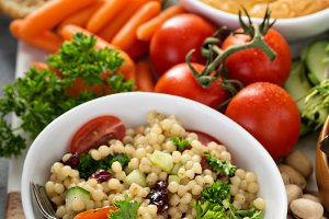 Pearl couscous salad with fresh vegetables