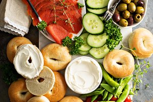 Big breakfast platter with bagels, smoked salmon and vegetables