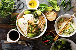 Asian food concept with fried rice, baby bok choy