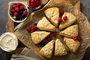 Freshly baked homemade scones with cream cheese