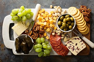 Cheese and snacks platter overhead shot