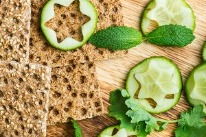Snack from Wholegrain Rye Crispbread Crackers and Cucumber