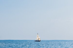 Lonely Sailing Boat in Sea