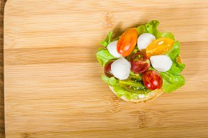 English muffin with heirloom tomatoes