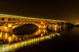 City bridge. Bridge at night. Bridge above river.