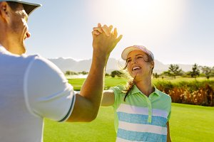 Golfers giving high-five