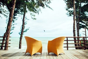 two armchairs on the beach