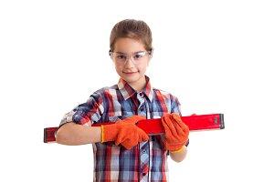 Little girl holding building level