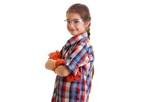 Little girl in glasses and gloves