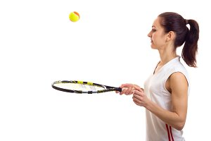 Woman playing with tennis racquet