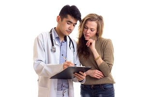 Male doctor talking to young woman