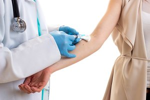 Male octor making injection of young woman