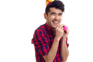 Young man blowing balloon