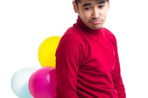 Young man holding balloons