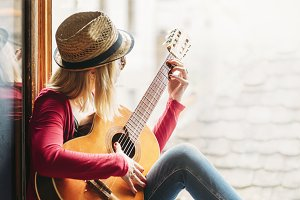 Woman plays the guitar