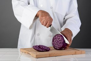 Chef Cutting a Head of Red Cabbage