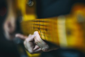 Hands playing musical instrument (Guitar)
