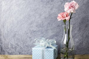 Pink carnation flowers and gift box