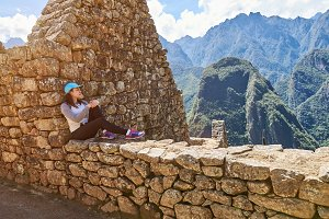 Girl traveller sit in Machu Picchu