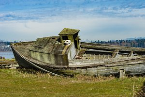 Abandoned wooden boat on shore