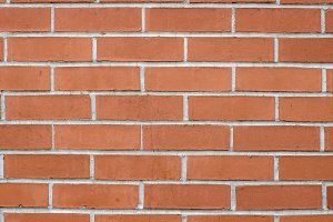 Red brick wall with mortar joints