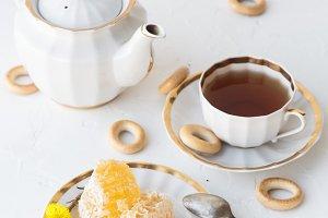 Tea with honey on white background