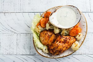 Grilled marinated chicken breasts and vegetables