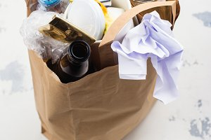 Craft paper bag with unsorted waste
