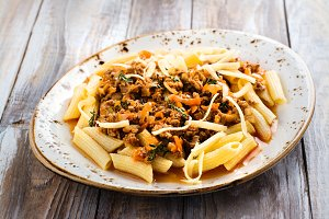Italian bolognese pasta on wooden table