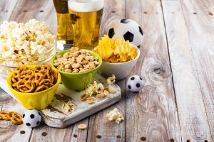 Beer and snacks on wooden table