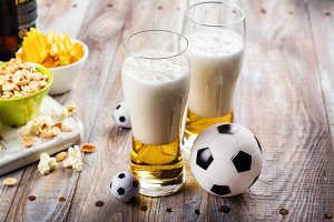 Beer snacks on wooden table