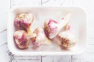 Garlic bulbs on wooden table