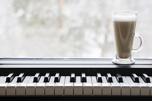 Coffee on the piano by the window