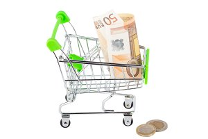 Fifty euro in the shopping pushcart, isolated on white